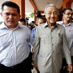 Malaysia's Mahathir proposes 'unity government' to strengthen grip