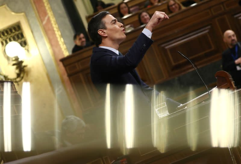Spain's Sanchez wins tight parliament vote to remain PM