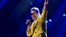 Take That's Howard Donald sports eyepatch on stage after freak injury