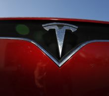 Tesla shares, fueled by Fed, surge on bullish analyst calls