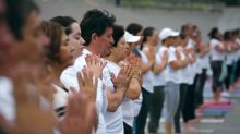 Yoga fans push for peace at the U.S.-Mexico border