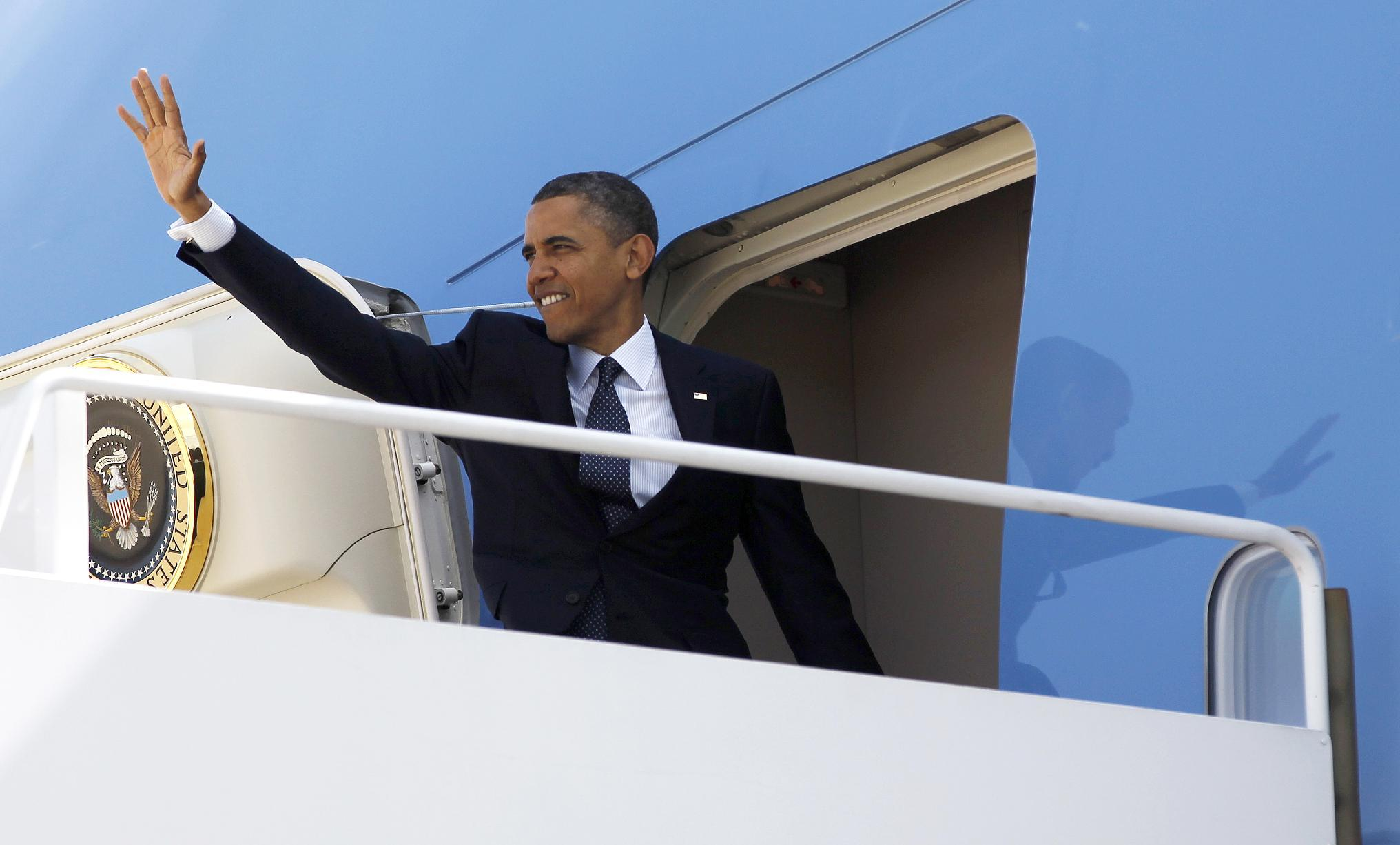 President Barack Obama waves as he board Air Force One before his departure from Andrews Air Force Base, Md.,Thursday, May, 10, 2012. Obama is traveling to the West Coast for a series of campaign fundraisers. (AP Photo/Pablo Martinez Monsivais)