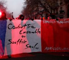 French strike against Macron reforms enters day two