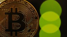 Bitcoin slumps below $7,000 mark for first time in 6 months