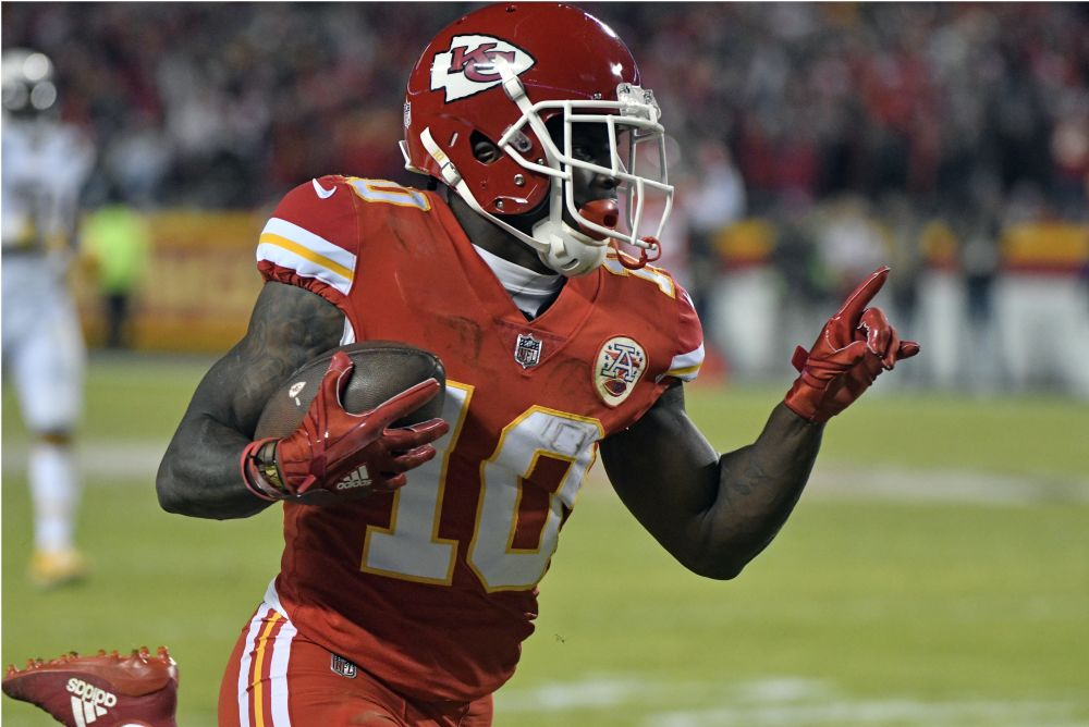 Wide receiver Tyreek Hill will try to lead the Chiefs to a wild-card win over the Titans. (AP)