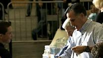 Romney collects food for Sandy victims