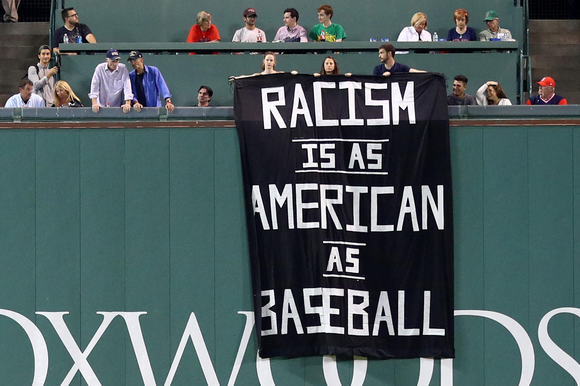 A high school baseball player in Iowa faced racist taunts during a game. His family wants the incident to spark rule changes addressing hateful jeering in sports.