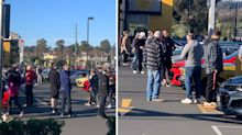 'NO social distancing': Massive crowd gathers at Coles for car show