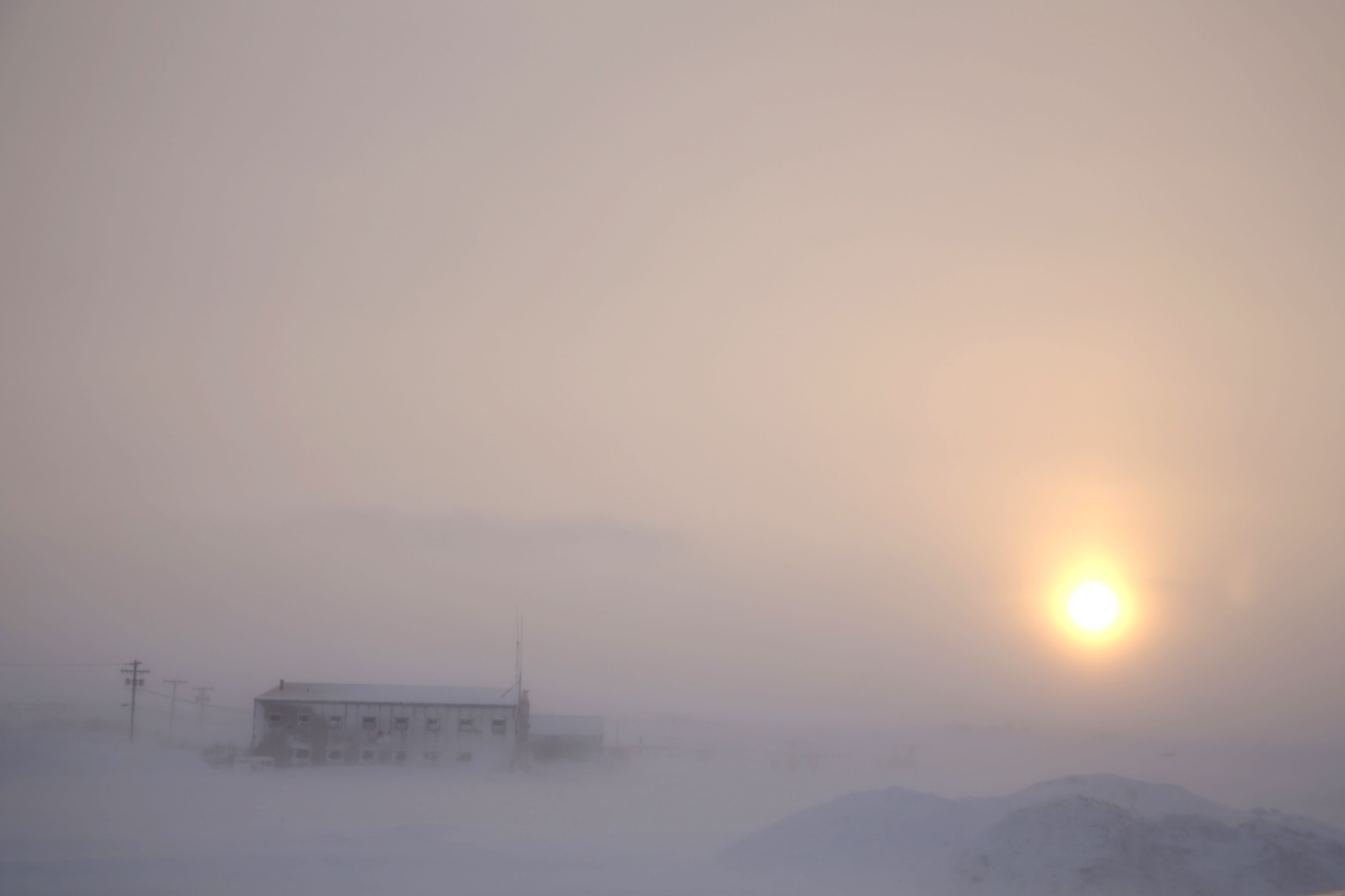 In this Feb. 13, 2019, photo, the afternoon sun hangs low as it shines through the snow at the airport in Nome, Alaska. Survivors and advocates contend that Nome police pay less attention and investigate less aggressively when sexual assaults are reported by Alaska Native women. (AP Photo/Wong Maye-E)