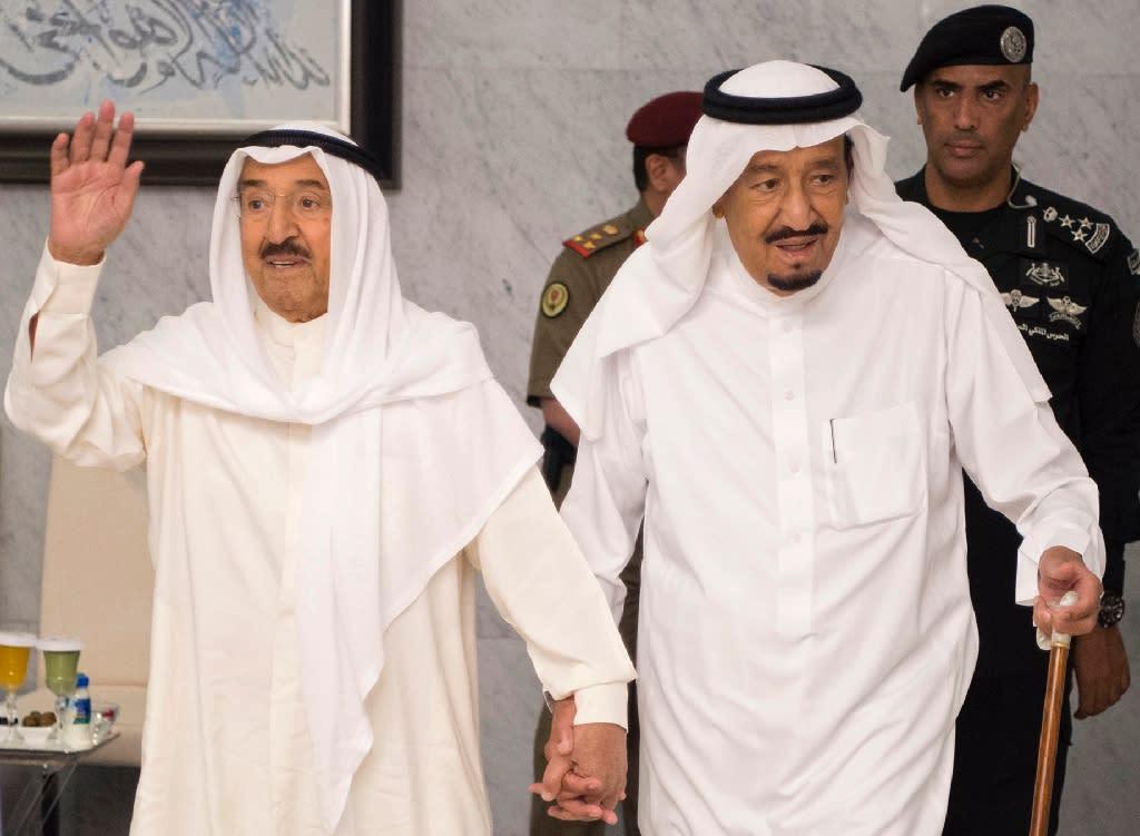Saudi King Salman bin Abdulaziz al-Saud (R) and Kuwaiti Emir Sheikh Sabah al-Ahmad al-Jaber al-Sabah arrive for a meeting in the Red Sea city of Jeddah on June 6, 2017 aimed at resolving the crisis between Qatar and its neighbours (AFP Photo/Bandar AL-JALOUD)