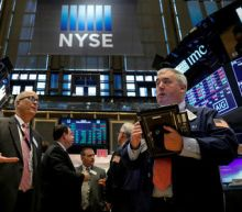 Wall Street ends flat; late gains on Fed Powell report