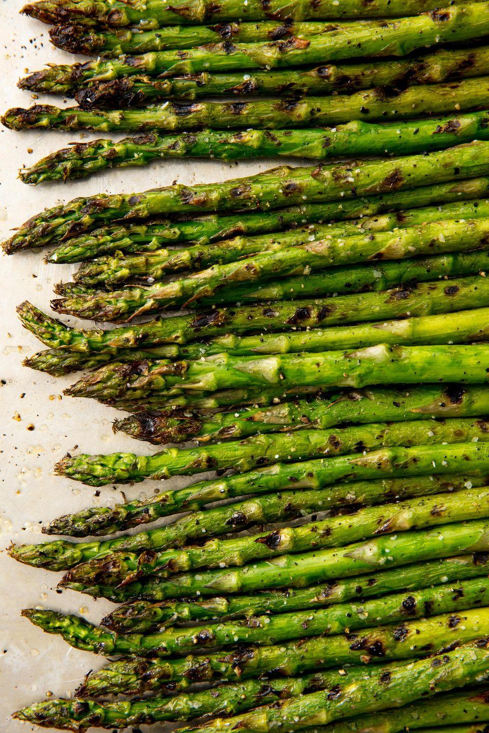 """<p>Fire up the grill!</p><p>Get the recipe from <a href=""""https://www.delish.com/cooking/recipe-ideas/recipes/a58383/best-grilled-asparagus-recipe/"""" rel=""""nofollow noopener"""" target=""""_blank"""" data-ylk=""""slk:Delish"""" class=""""link rapid-noclick-resp"""">Delish</a>. </p>"""