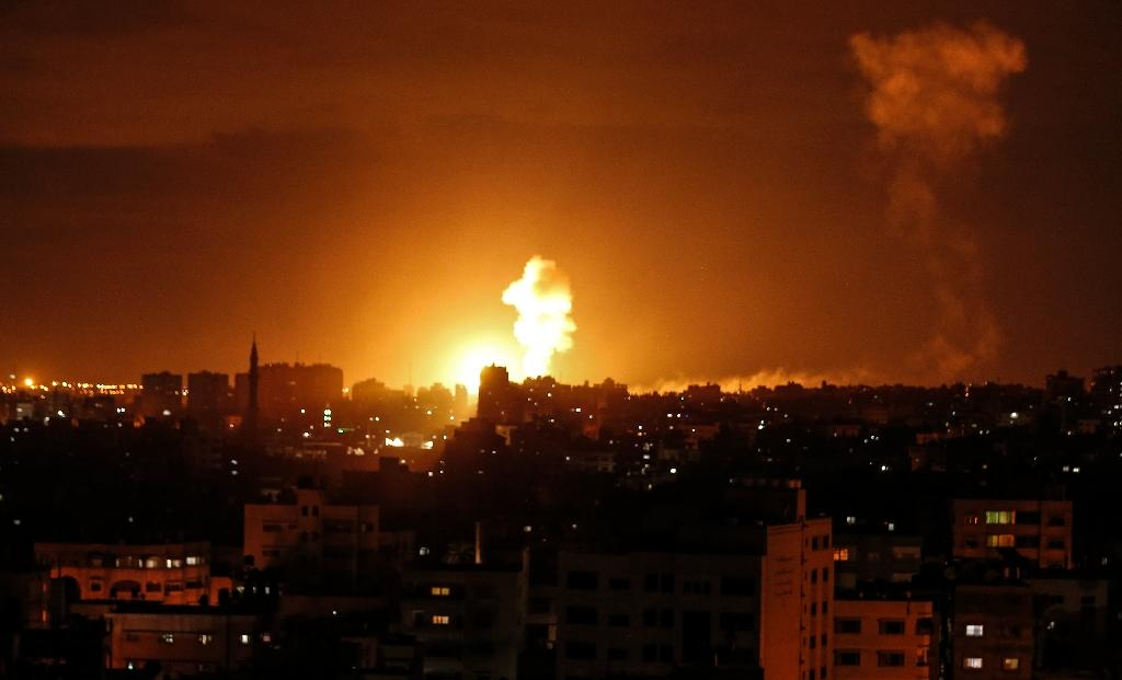 A fireball rises over Gaza City following an Israeli air stike on October 27, 2018, one of around 90 carried out in response to the most extensive rocket fire against Israel in months
