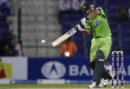 FILE PHOTO - Pakistan's Shahzaib Hasan plays a shot during their first Twenty20 international cricket match against South Africa in Abu Dhabi