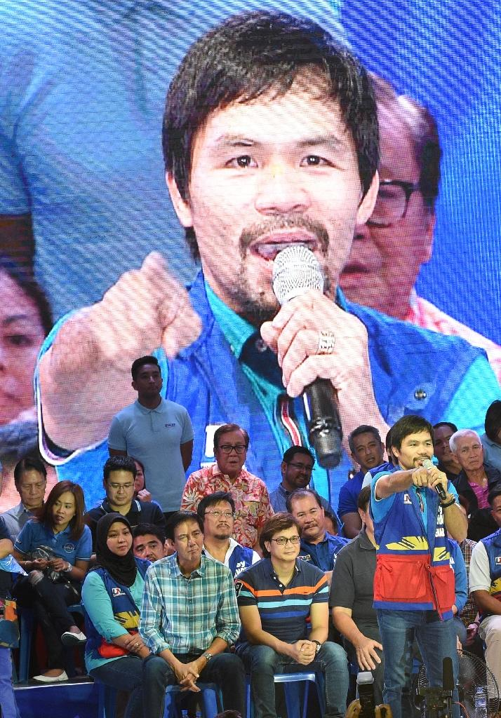 Manny Pacquiao is running for a Senate seat in May elections -- with an eye on an eventual presidential run -- and his star power in a nation famed for its celebrity-obsessed politics is likely to see him win (AFP Photo/Ted Aljibe)
