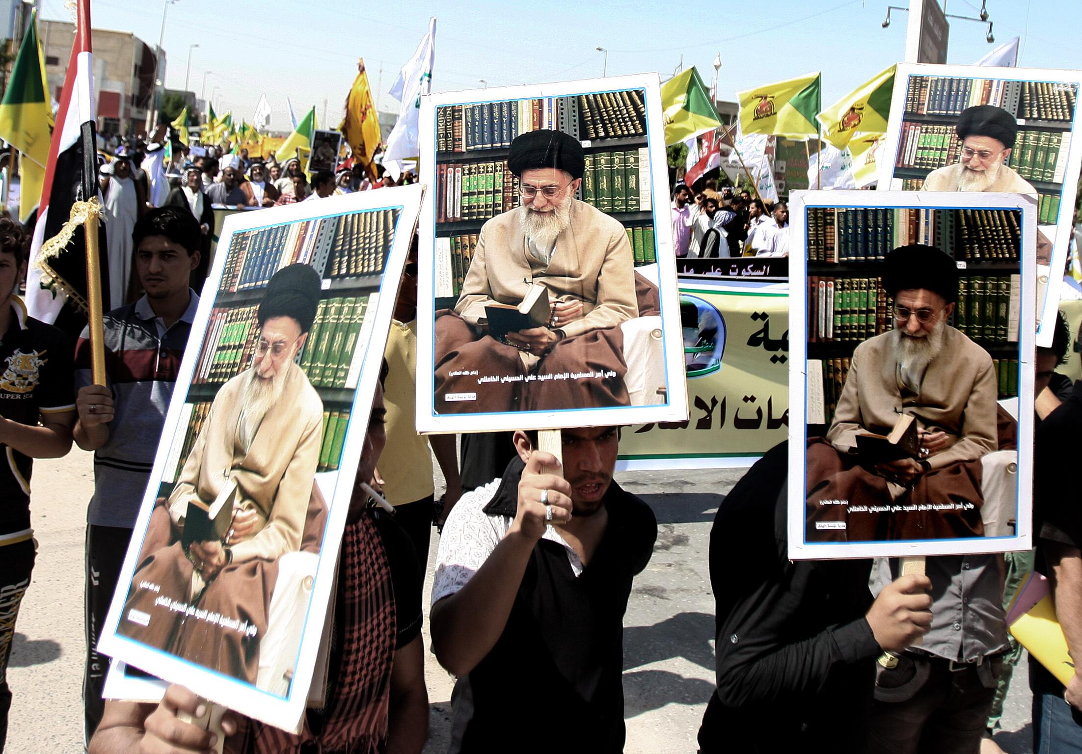 In this Sept. 21, 2012, photo, Iraqis chant slogans as they hold posters of Iran's supreme leader Ayatollah Khamenei during a protest in Basra, 340 miles (547 kilometers) southeast of Baghdad, Iraq, as part of widespread anger across the Muslim world about a film ridiculing Islam's Prophet Muhammad. After years of growing influence, a new sign of Iran's presence in Iraq has hit the streets. Thousands of signs, that is, depicting Iran's supreme leader gently smiling to a population once mobilized against the Islamic Republic in eight years of war. (AP Photo/Nabil al-Jurani)