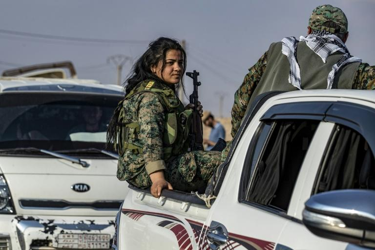 Fighters from Kurdish-led forces withdrew from the Sanjak Saadoun border area near the northern Syrian town of Amuda (AFP Photo/Delil SOULEIMAN)