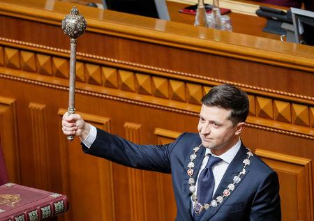 Ukraine's President-elect Volodymyr Zelenskiy takes the oath of office during his inauguration ceremony in the parliament hall in Kiev