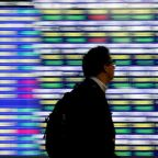 Global Markets: Asia shares inch up, Fed caution curbs dollar