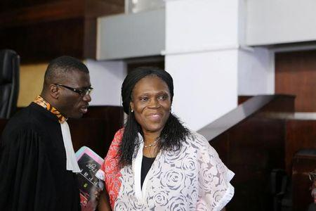 Ivory Coast's former first lady Simone Gbagbo, who is accused of crimes against humanity and war crimes for her alleged role in a 2011 civil war, arrives in a domestic court in Abidjan