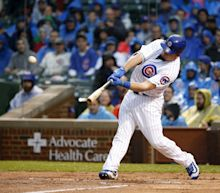 Kyle Schwarber hits homer onto the street outside Wrigley Field