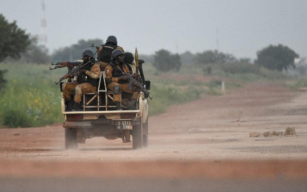 Burkinabe gendarmes patrol near the Presidental Security Regiment (RSP) military barracks on September 29, 2015 in Ouagadougou
