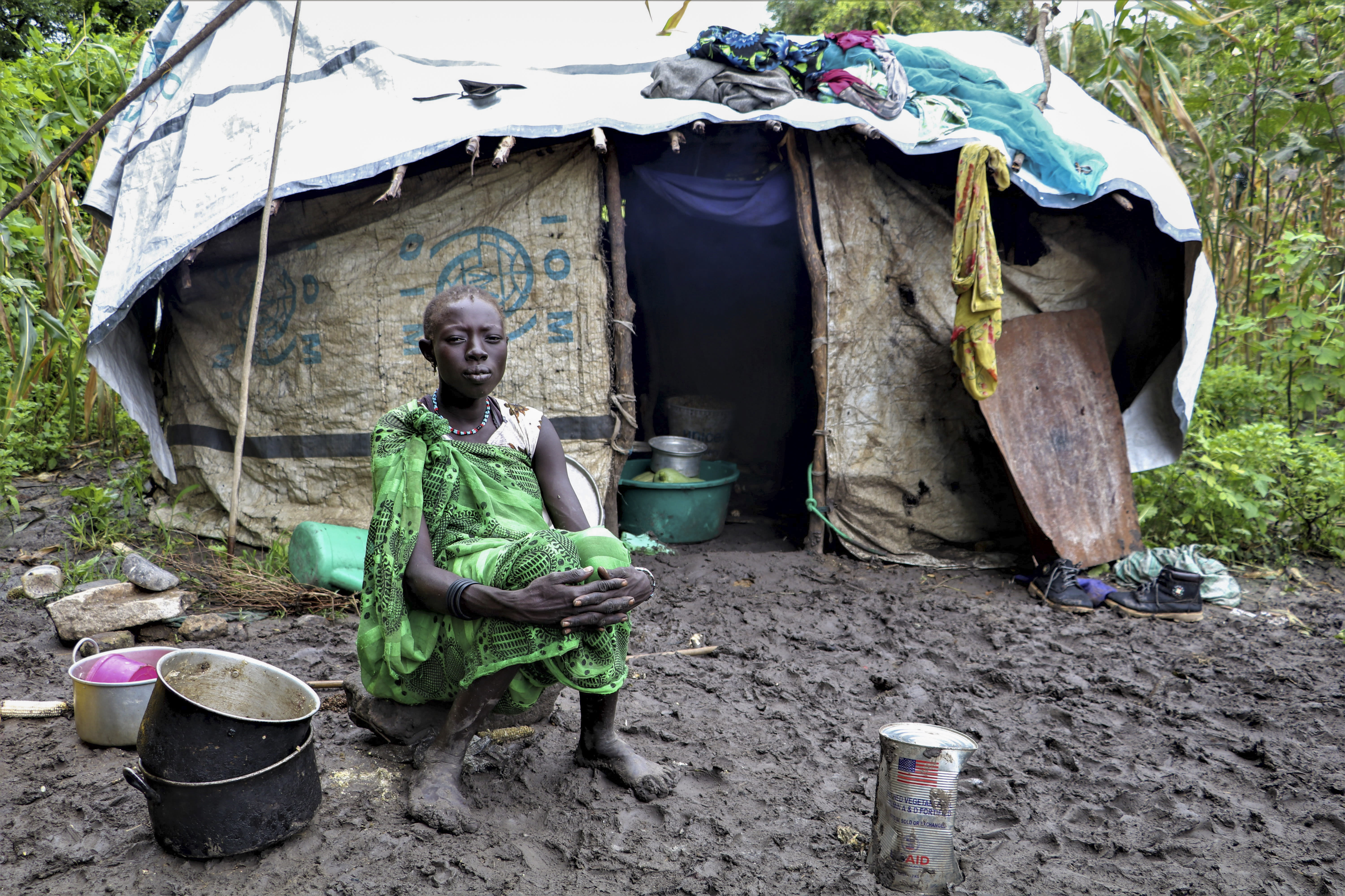 A young woman sits in front of her shelter after heavy rainfall and flooding destroyed her crops, in Lukurunyang in the Greater Pibor Administrative Area, South Sudan, Monday, Sept. 7, 2020. Flooding has affected well over a million people across East Africa, another calamity threatening food security on top of a historic locust outbreak and the coronavirus pandemic. (Tetiana Gaviuk/Medecins Sans Frontieres via AP)
