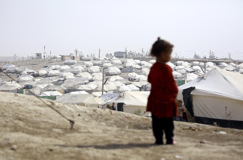 An Iraqi child at the Al-Hol refugee camp in Syria's Hasakeh province on October 25, 2016 (AFP Photo/Delil Souleiman)