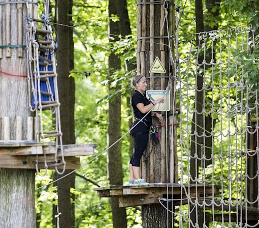 Zip line company: Woman who fell had unhooked safety gear