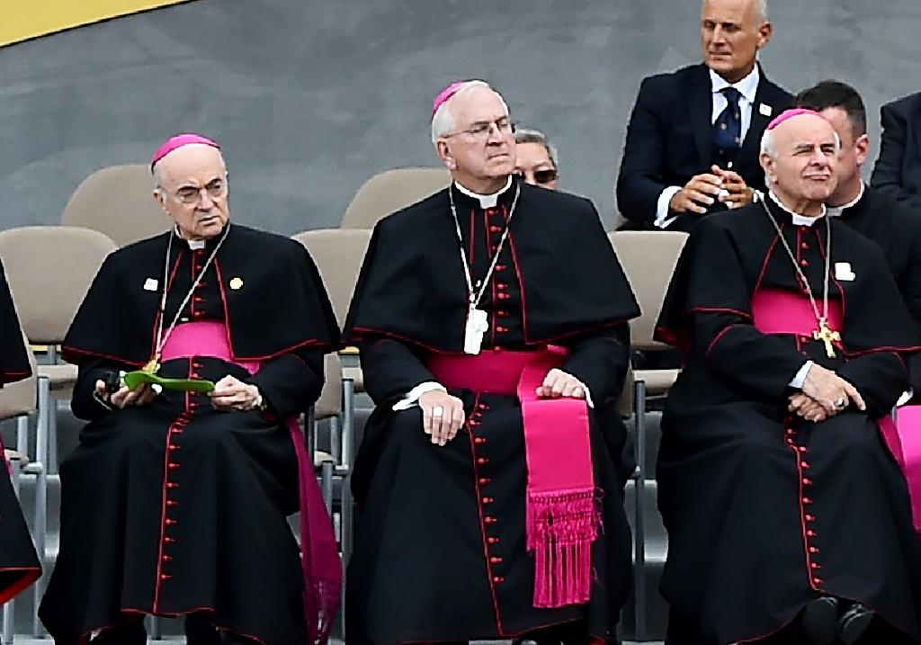 Carlo Maria Vigano (L), the former Vatican ambassador to the United States, with other prelates as they listen to a speech by Pope Francis in Philadelphia on September 25, 2015