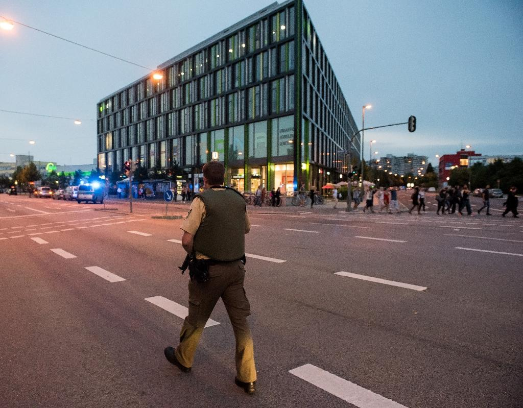 A policeman patrols as people are beeing evacuated from the Olympia Einkaufzentrum (OEZ) in Munich