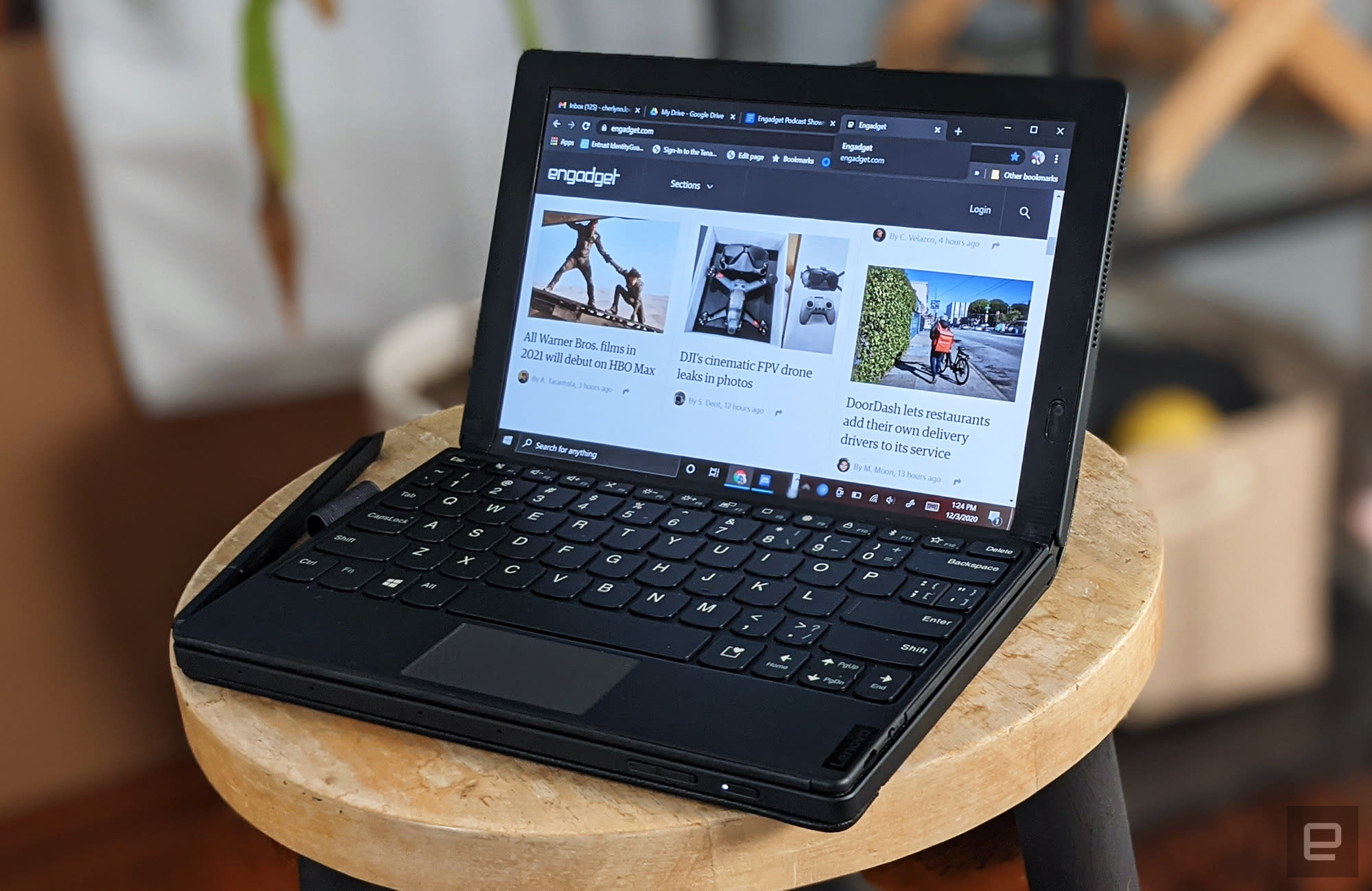 ThinkPad X1 Fold tablet/laptop displayed on a stool.