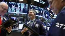 Wall Street inches up with financials; earnings in focus