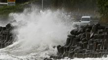 Typhoon unleashes rain, strong winds in southern Japan