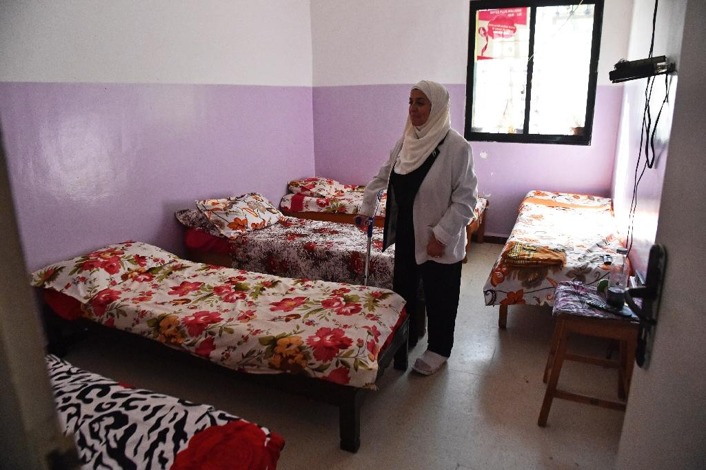 Cancer charity chief Samia Gasmi says some women end up in shelters because they have nowhere to go after their husbands leave them (AFP Photo/RYAD KRAMDI)