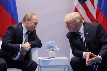 FILE PHOTO: Russia's President Vladimir Putin talks to U.S. President Donald Trump during their bilateral meeting at the G20 summit in Hamburg