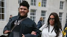 Katie Price shares picture of boarded-up window amid her claims that son Harvey 'bashed them in'