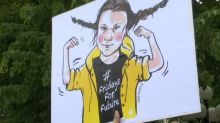 'Fearless girl' Greta Thunberg faces down Trump in new political cartoon