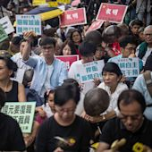 China Sentences Two Hong Kong Journalists to Prison For Up to Five Years