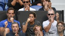 The Latest: Mauresmo coaches Pouille to 1st Slam semifinal