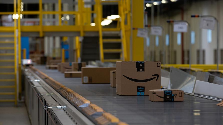 Amazon to give Prime customers one-day shipping, cutting free delivery time in half