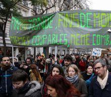 Thousands march for climate in Paris despite 'yellow vest' unrest