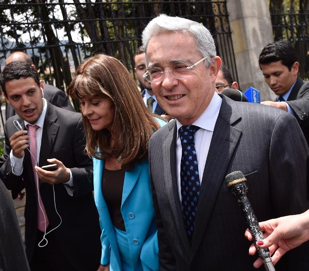 Colombian former president and current senator Alvaro Uribe (R) and Colombia former presidential candidate Marta Lucia Ramirez arrive at Narino Palace in Bogota for a meeting with Colombian President Juan Manuel Santos on October 5, 2016