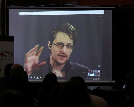 Edward Snowden speaks via video link during a conference at University of Buenos Aires Law School