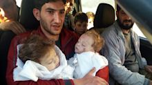 A father bids farewell to twin toddlers after Syria attack