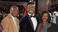 John Boyega shares footage of emotional moment he told parents he'd bought them a house