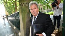 Peter Foster walks after fraud jail term