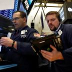 Wall Street opens lower as chip stocks, Apple drag