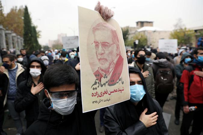 A protester holds a picture of Mohsen Fakhrizadeh, Iran's top nuclear scientist, during a demonstration against his killing in Tehran, Iran, November 28, 2020. Majid Asgaripour/WANA (West Asia News Agency) via REUTERS ATTENTION EDITORS - THIS IMAGE HAS BEEN SUPPLIED BY A THIRD PARTY.
