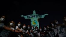 Brazil's Christ the Redeemer statue lights up for vaccine equality